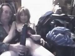 What do you think this insane mature slut feels, when giant black dildo permeates her large stretched cunt?