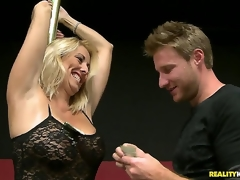 This raunchy blonde milf was showing the males the location for the charity poker tournament, and she used the excuse to do a little dance routine on the pole. And thats just the start...