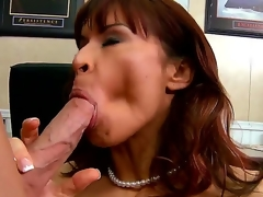 Seductive brunette pornstar Devon Michaels receives seduced by the Johnny Sins. This prepossessing milf with a big and yummy tits receives kissed and begins to sucks her partners cock.