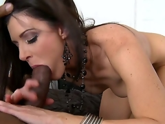 The licentious brunette milf India Summer can't live without anything big and she couldnt pass by this dark monster cock and pleasingly took it so deeply right in the mouth
