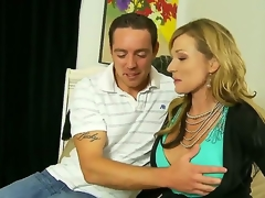 Mature/MILF and hot Nicole Wright is the best stepmother ever. This blonde babe is breathtaking as she lets her stepson rub her big juicy tits. This babe then gets his cock out and gives him a great oral-service before she gives him a great tit fuck.