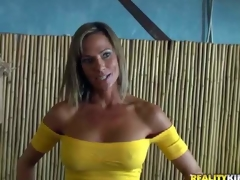 Shes a pretty MILF with big fake breasts and skinny figure. Leggy well stacked woman in yellow blouse and blue skin tight jeans turns guy on. MILF Hunter cant resist! She is devilishly sexy