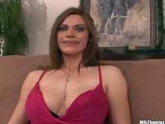 This well-endowed woman finds herself side by side with MILF Hunter on the couch after playing golf together. She flashes her gorgeous large melons and gievs a smile that guy cant resist!