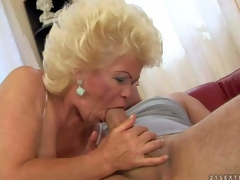 Effie is a blond-haired mature whore with fuckable titties. She strokes young hard jock with her wonderful juggs and then takes it in her mouth. She shows her hairy mature pussy while doing it