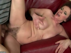 Babuska is a slutty oldie that gets her unshaved soaked pussy drilled by young hard cock. This aged woman cant receive enough. Boy bangs her bush hard on the couch and makes her squirt