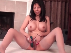 Mommy with big round love bubbles fucks a dildo