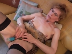 Older in stockings and underware has dildo sex