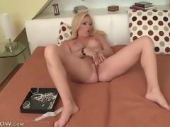 Large titty blonde milf masturbates her hawt aperture