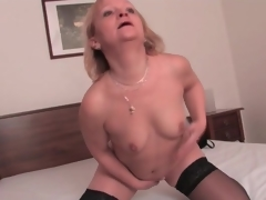 Stout older blonde in dark nylons