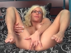 Large fake titty babe Puma Swede sits on toy