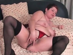 Fat mature in nylons and pants masturbates