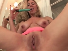 Aged plays with her billibongs and pussy in washroom