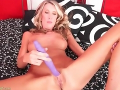 Masturbating blonde mama with big fake titties