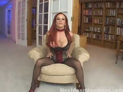 Redhead mommy swallows cum from a large rod