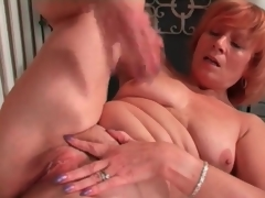 Older redhead rubs her love button in masturbation porn