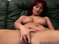 Messy redhead MILF with huge love melons goes horny on the couch